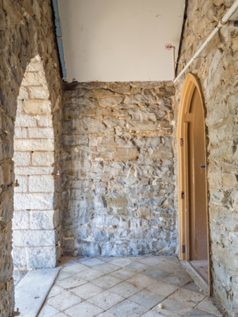 North entry vestibule, stripped for repointing of stone walls