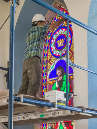 Tenney Memorial stained-glass window being prepared for removal and shipping to safe storage for duration of project